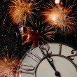 Stock Photo: Old vintage clock and fireworks