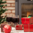 Christmas gift boxes and red wine — Stock Photo