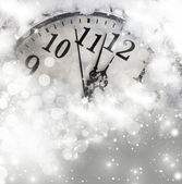 Old clock with stars snowflakes and holiday lights — Stock Photo