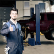 Handsome car mechanic at work — Stock Photo