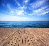 Sea and wooden walkway — Stock Photo
