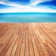 Sunny sea and wooden walkway — Stock Photo #46071711