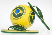 Flip flops and soccer ball — Stock Photo