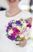 Beautiful wedding bouquet in bride hands — Photo