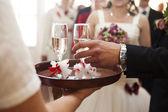 Waiter serving champagne — Stock Photo