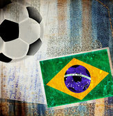 Soccer ball and Brazil flag — Stock Photo