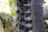 Old wooden gears a watermill — Stock Photo