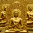 Stock Photo: Golden Buddha meditation.