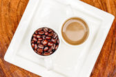 Coffee and beans on the wooden background. — Stock Photo