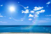 Blue sky with cloud closeup on the beach — Stock Photo