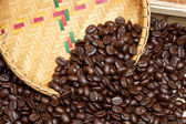 Coffee beans and basketry background. — Stock Photo