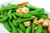 Fried shrimp with fresh peas. — Stock Photo