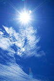 Blue sky with cloud and sun. — Stock Photo