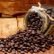 图库照片: Roasted coffee beans on wood and black coffee Arabica.