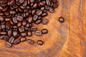 Roasted coffee beans on wood. (Arabica coffee) — Stock Photo