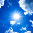Blue sky with clouds and sun. — Stock Photo #34448151