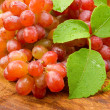 Fresh red grapes on brown wood. — Stock Photo #34463501
