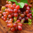 Fresh red grapes on brown wood. — Stok Fotoğraf #34466437