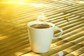 Morning coffee on the bamboo — Stock Photo
