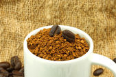 Roasted coffee beans. And instant coffee. — Stock Photo