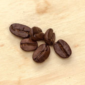 Coffee beans on the wooden — Stock Photo
