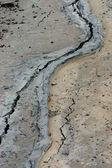 The asphalt road surface crack due to ground collapsing. — Stock Photo