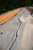 The asphalt road surface crack due to ground collapsing. — Stock fotografie