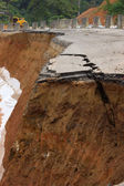 Side of the broken asphalt road collapsed and fallen, since the — Stock Photo