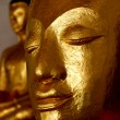 Close up shot of the smile Buddha's face — Stock Photo