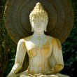 Stock Photo: White Buddhstatues. Meditate and relax.
