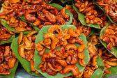 Sugar coated cashew nut on the foliage. — Stock Photo
