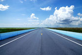 Blue sky with could, Empty road and the traffic lines. — Stock Photo