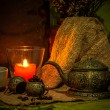 Still life with candle and ancient silver teapot. — Stock Photo