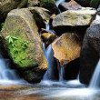 Small Waterfalls flowing over the rock. — Stock Photo