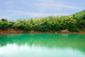 Green water lake in the Mountains. — Stock Photo