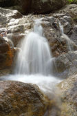 Small Waterfalls flowing over the rock. — 图库照片