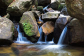 Small Waterfalls flowing over the rock. — Stockfoto
