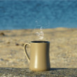 Coffee at the beach in the morning light and sunrise. — Stock Photo