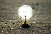 Light bulb on the beach. — Stock Photo