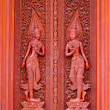 Antique carved wooden door in temple Thailand — Stock Photo