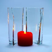 Red candles in glass cracking. — Stok fotoğraf