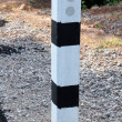 Stock Photo: Stone pillars prevent accidents on road curved.