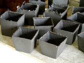 Black clay ceramic cups before drying — Stock Photo