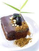 Chocolate cake with Black olives on white isolated background — Foto Stock
