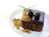 Chocolate cake with Black olives on white isolated background — Stock Photo