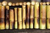 Thai Dessert, Bamboo on the fire burning. — Stock Photo