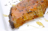 Salmon fried with spices and topped honey — Stock Photo