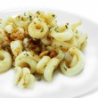 Fried squid with garlic and rosemary mixture. — Stock Photo