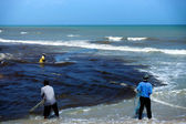Casting fishermen in the Black Sea wastewater. — Stock Photo