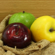 Stock Photo: Three color apple on fabric.